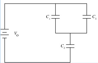 In the circuit sketched in Fig., C1 = 6.3 times 10