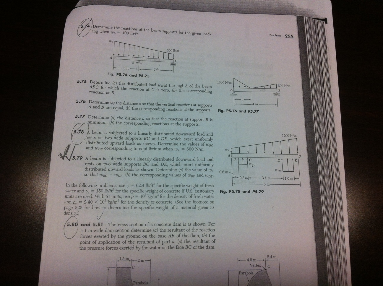 Determine the reactions at the beam supports for t