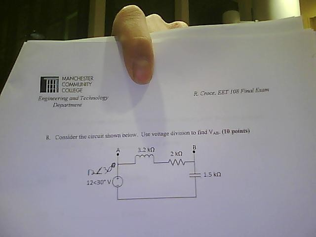 Consider the circuit shown below. Use voltage divi