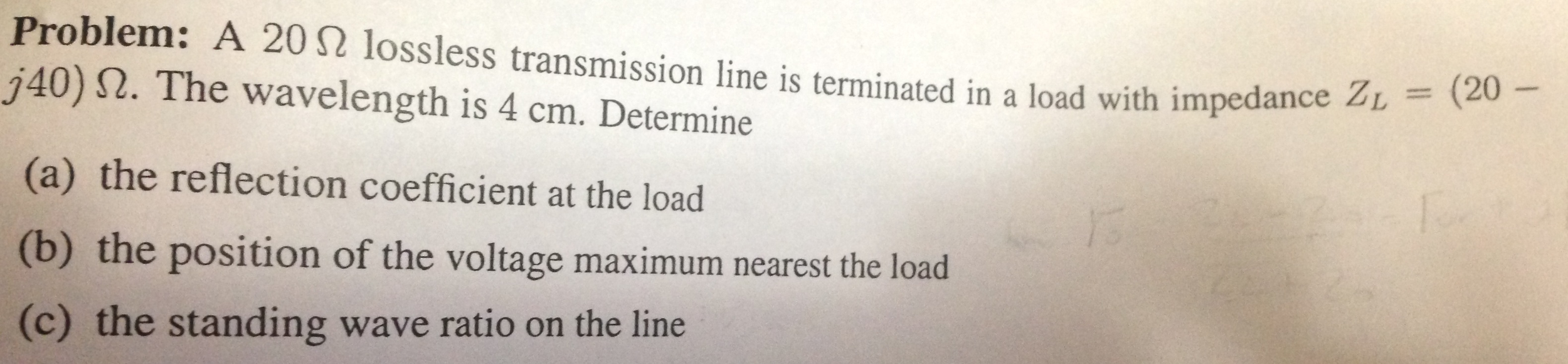 A 20 ohm lossless transmission line is terminated