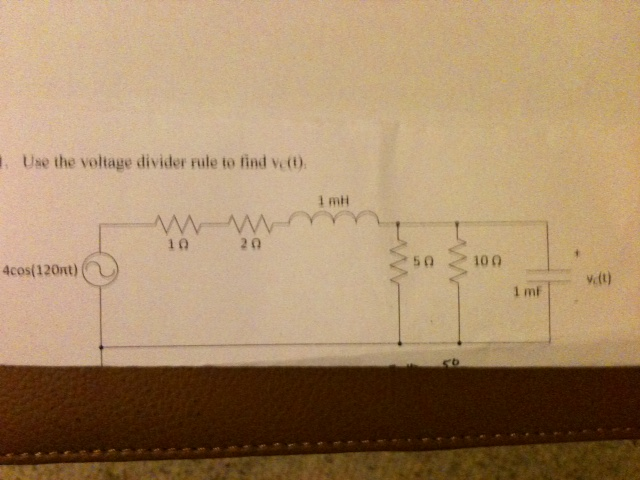 Use the voltage divider rule to find .