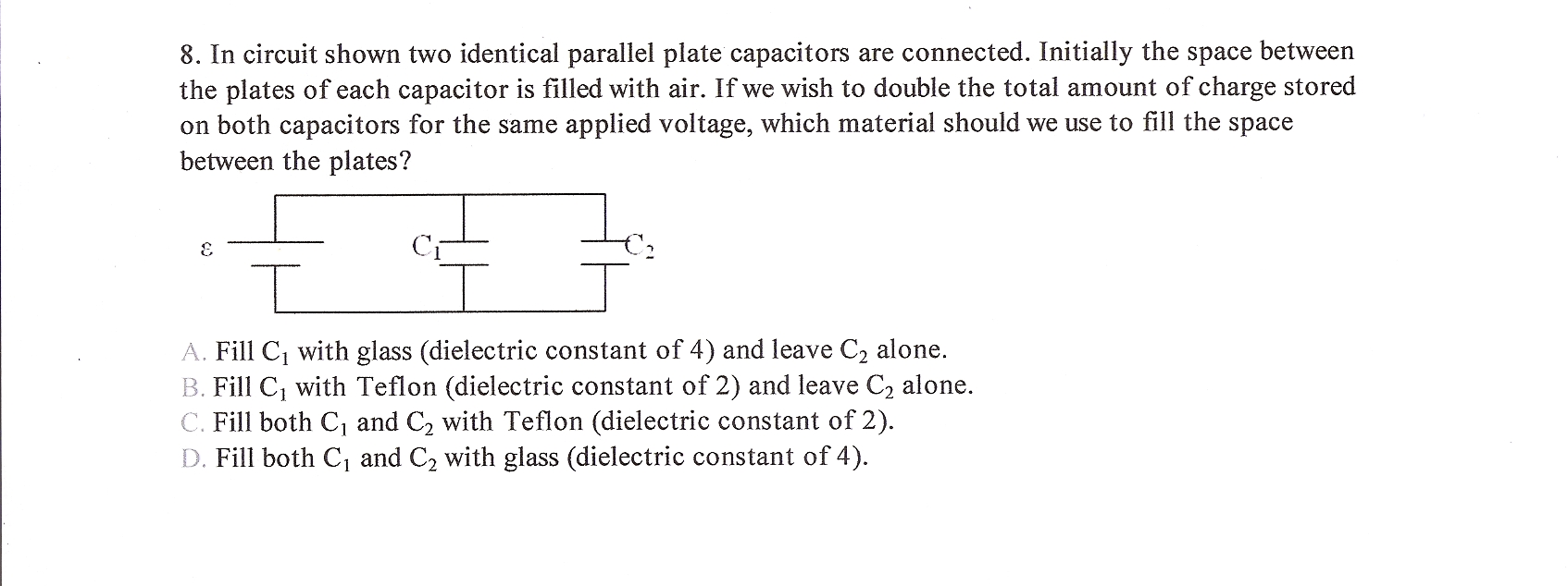 In circuit shown two identical parallel plate capa