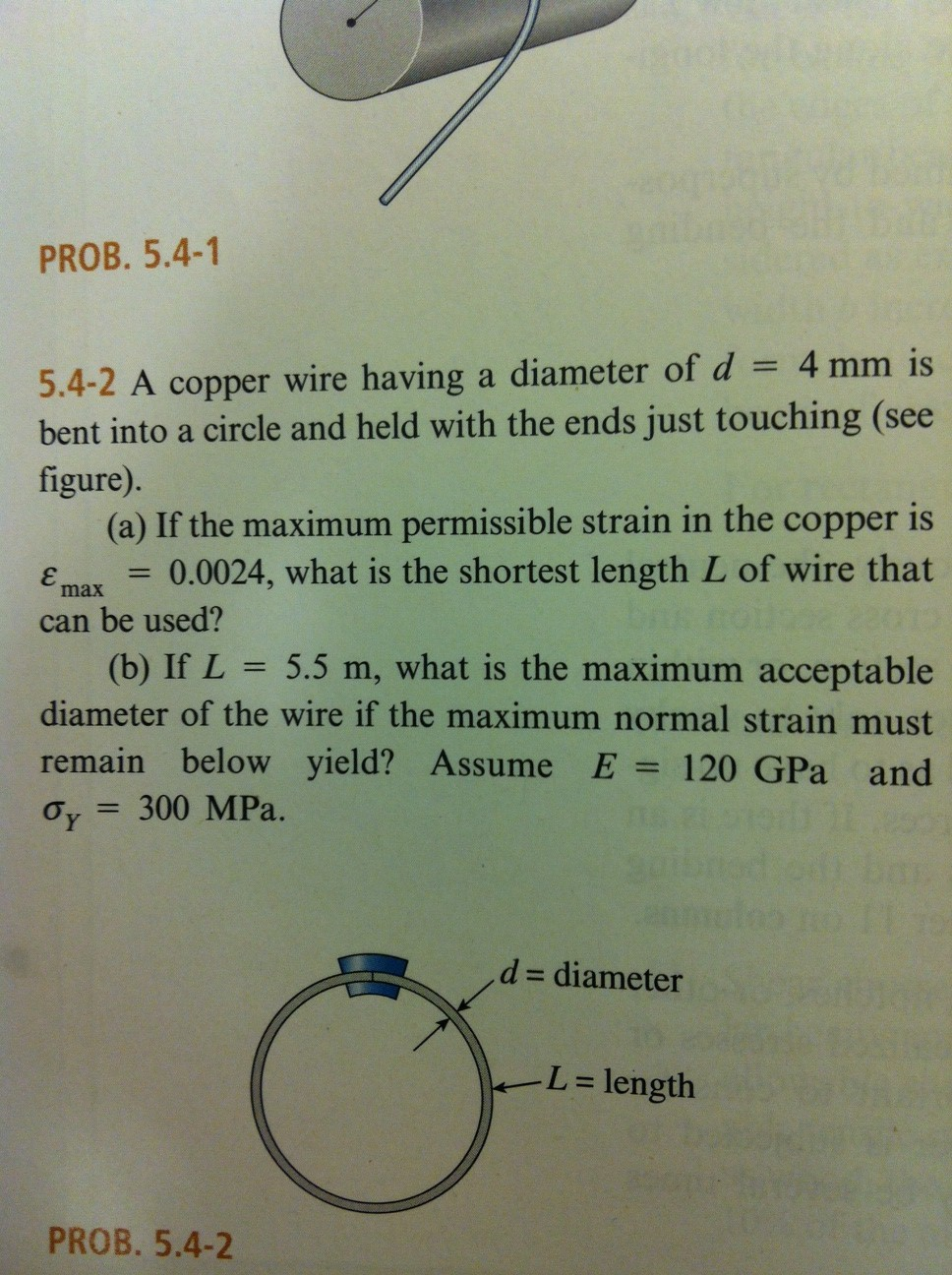A copper wire having a diameter of d = 4 mm is ben