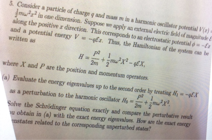 Consider a particle of charge q and mass m in a ha